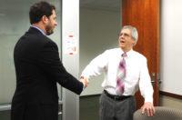 Handshake in board room