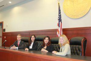 4 lawyers sitting