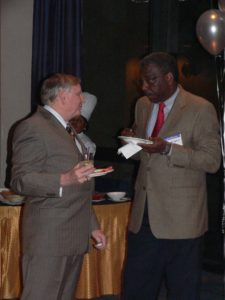 2 lawyers at CLS 30th Anniversary eating