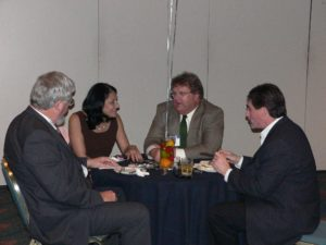 4 lawyers talking and eating at CLS 30th Anniversary Reception 2007