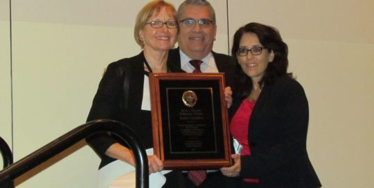 Nancy Daniels with Carlos Martinez & Judge Angelica Zayas holding award
