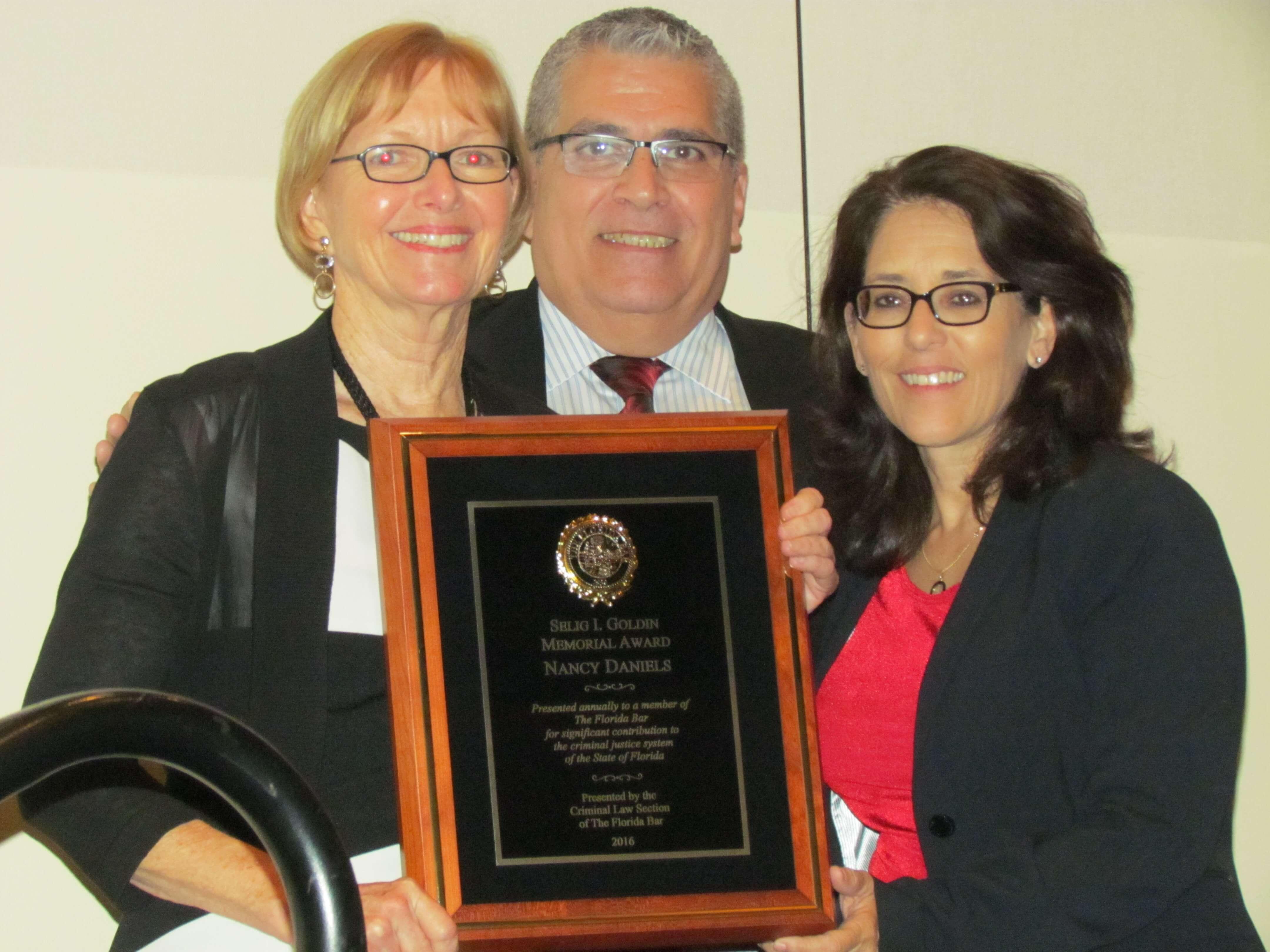 Nancy Daniels with Carlos Martinez & Judge Angelica Zayas photo